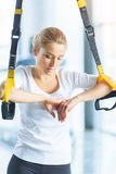 Sportswoman training with resistance band in sports center Stock Image