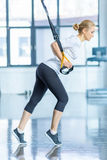 Sportswoman training with resistance band in sports center Royalty Free Stock Images
