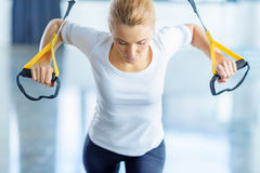 Sportswoman training with resistance band in sports center Royalty Free Stock Photography