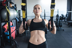 Sportswoman training with trx resistance band Stock Photos