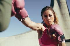 Sportswoman practicing boxing outdoors royalty free stock image