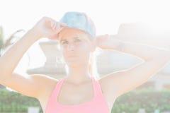 Sportswoman wearing cap Royalty Free Stock Photos
