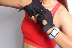 Sportswoman wearing smartwatch device Royalty Free Stock Photos