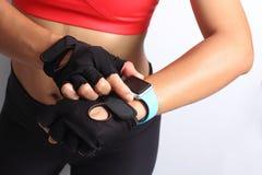 Sportswoman wearing smartwatch device Stock Image