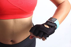 Sportswoman wearing smartwatch device Stock Images