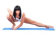 Sportswoman on a white background Royalty Free Stock Photo