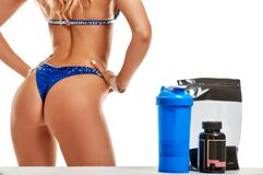 Sportswoman With Nutritional Supplements Stock Photos
