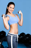 Sportswoman works out with dumbbells Stock Images