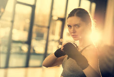 Sportswoman with wraping hands ready to fight Royalty Free Stock Image