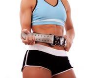 Sportswomanbefestigung ihr Gurt Stockbilder