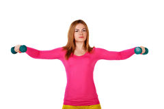 Sportswomen do exercises with dumbbells. Royalty Free Stock Image
