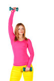 Sportswomen do exercises with dumbbells. Stock Image