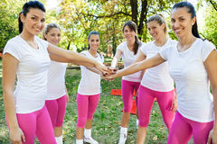 Sportswomen with hands together Stock Photography