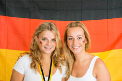Sportswomen Standing Against German Flag Stock Images