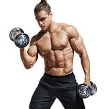 Sporttive man doing exercises with dumbbells at biceps. Photo of young man with naked torso and good physique isolated on white background. Strength and stock images