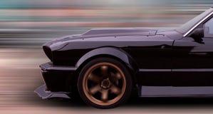 Sportwagen in der Bewegung Stockbild