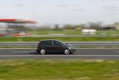 Sportwagen die zich snel beweegt Stock Afbeelding