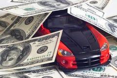 Sportwagen en geld Stock Foto's