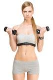 Sporty девушка с гантелями стоковые изображения