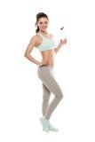 Sporty питьевая вода от бутылки после разминки, тренировка девушки фитнеса, изолированная на белой предпосылке Стоковое фото RF