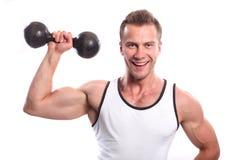 Sporty сексуальный человек представляя в спортзале Стоковая Фотография