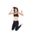 Sporty active young woman gesturing thumbs up Royalty Free Stock Photography