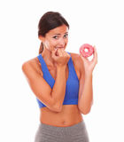 Sporty adult woman holding tempting food Royalty Free Stock Photo