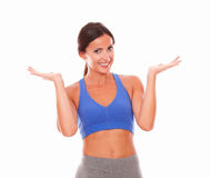 Sporty adult woman putting palms up Stock Image