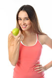 Sporty Aerobics Girl offering apple. Aerobics girl offering an apple in her hand Stock Image
