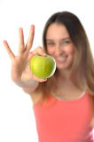 Sporty Aerobics Girl offering apple. Aerobics girl offering an apple in her hand Royalty Free Stock Photos