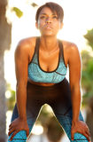 Sporty african american female relaxing after workout Royalty Free Stock Images