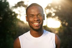Sporty african american man smiling outdoors Stock Images