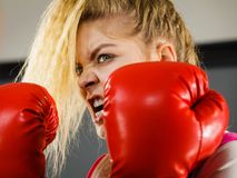 Angry woman wearing boxing gloves Royalty Free Stock Image