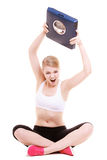 Sporty angry woman with scale, weight loss time for slimming Royalty Free Stock Images
