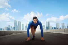 Sporty asian man runner getting ready for running on road Royalty Free Stock Photo