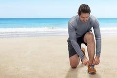 Sporty asian man tightening running shoe lace Stock Photo