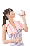 Sporty asian woman drinking water from a bottle Stock Images