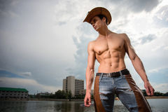 Sporty, athletic, muscular sexy man in a cowboy outfit Royalty Free Stock Images