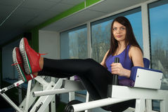 Sporty athletic woman doing exercises in gym Stock Photos