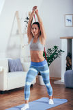 Sporty athletic woman exercising with rubber tape Stock Photography