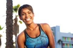 Sporty attractive african american woman laughing Stock Photo