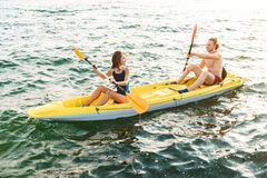 Sporty attractive couple kayaking royalty free stock photo