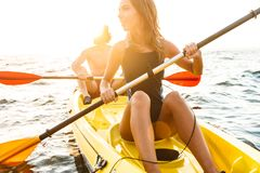Sporty attractive couple kayaking stock photography