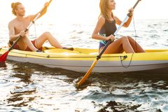 Sporty attractive couple kayaking royalty free stock photography
