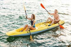 Sporty attractive couple kayaking stock photos