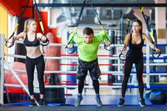 Young handsome trainer with young and sporty woman in the gym. Sport concept. stock photo