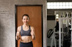 Sporty beautiful asian women posture standing and lifting thump up,Happy and smiling. Sporty beautiful asian woman posture standing and lifting thump up,Happy royalty free stock photos