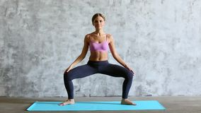 Sporty beautiful woman in sportswear workout indoors, full length. stock video footage