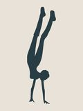 Sporty beautiful young woman doing handstand. Sporty beautiful young woman working out, doing handstand. Vector silhouette illustration isolated on grey Stock Photography