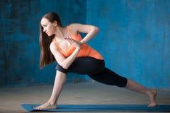 Sporty beautiful young woman Doing Parivritta Parsvakonasana Pos Stock Images